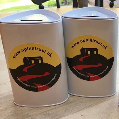 uphill donation tins