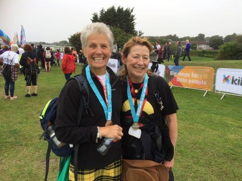 uphill kiltwalkers with medals