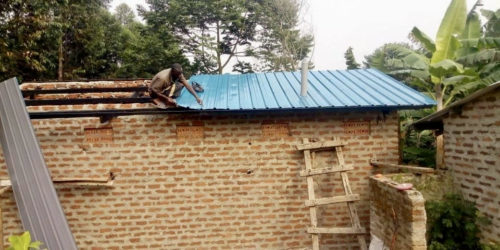 Putting the roof onto the latrine